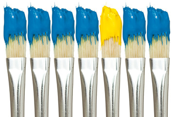 Paint brushes with blue and yellow paints