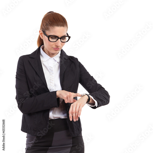 Woman in glasses checking hers watch.