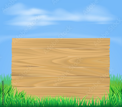 Wooden sign in field
