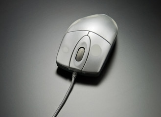 Used computer mouse on dark gray background