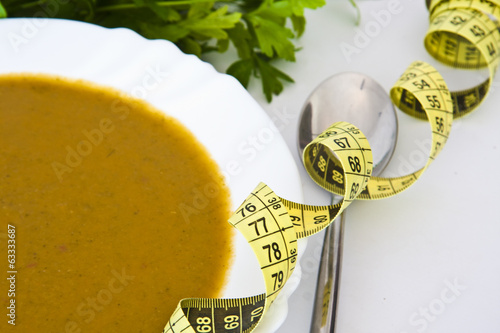 tape measure with healthy food to lose weight