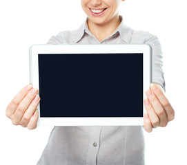 Woman showing a blank horizontal tablet screen