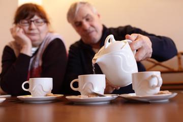 Senior man pouring tea