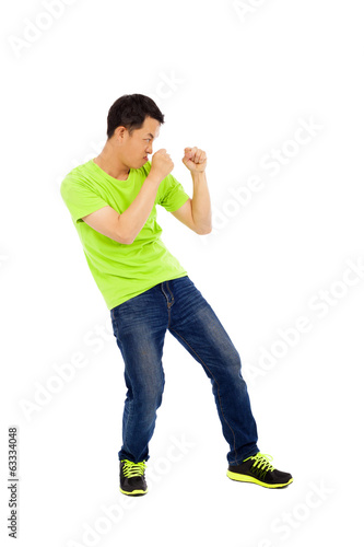 young man imitate boxing ready pose