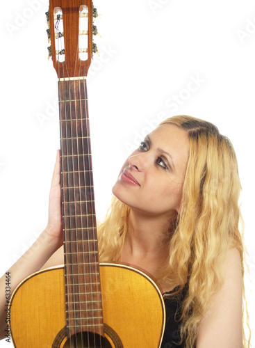portrait of young woman with guitar