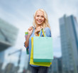 smiling woman with many shopping bags