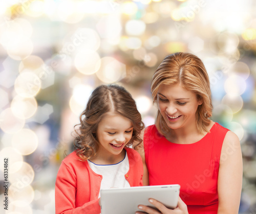 mother and daughter with tablet pc computer