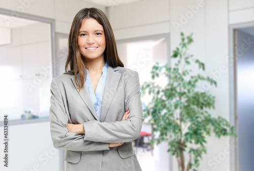 Friendly young businesswoman in her office