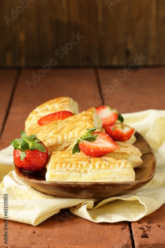 dessert patties puff pastry with strawberries on wooden table