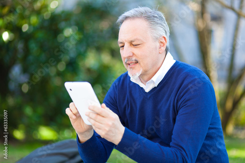 Senior using a tablet