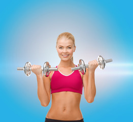 smiling woman lifting steel dumbbells