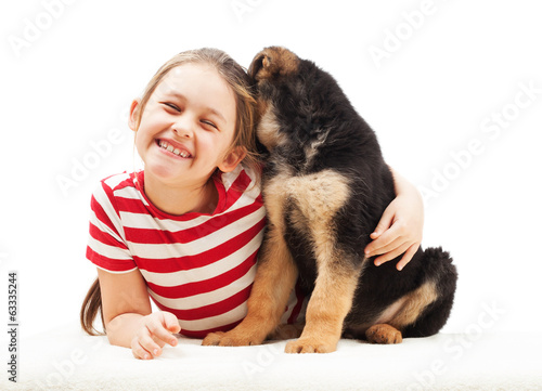 cheerful little girl hugging a puppy
