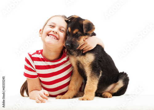 cheerful child tenderly hugging a puppy