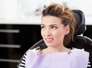 Worried woman patient waiting to be checked up at the dentist