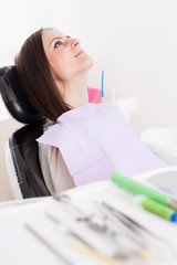 Woman patient at the dentist with instruments in the blurred fo