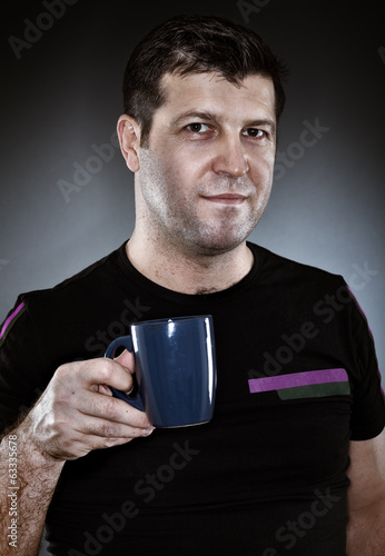 Closeup of a man holding a mug of coffee