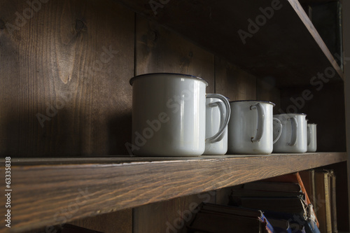 Old white enamel mugs