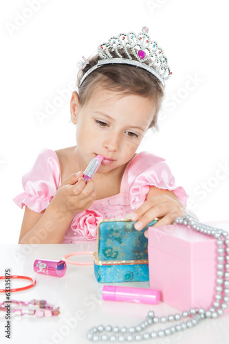 Little princess with a lipstick and crown