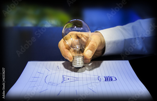 concept of idea: writing using a light bulb
