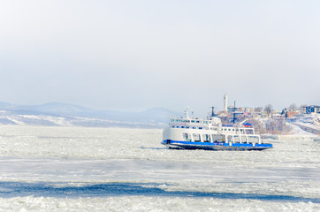 Ferry Crossing a Frozen River