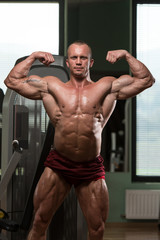 Bodybuilder Performing Front Double Biceps Pose