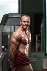 Bodybuilder Performing Side Triceps Pose