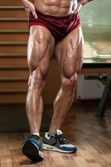 Close-Up of Bodybuilders Legs Ready For Competitive Sport