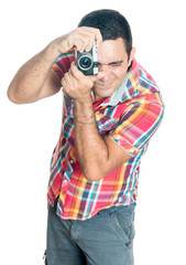 Hispanic man using a vintage looking compact camera