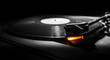 old style turntable with needle - b&w and orange light - 63338849