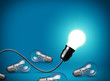 Idea concept with glowing light bulb