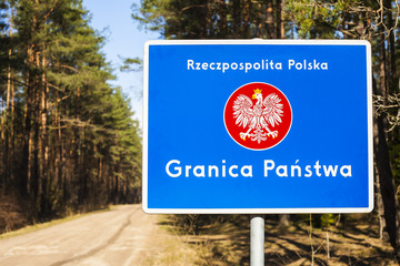 Border post with the emblem of the Poland.