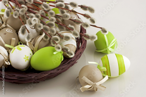 Easter still life with colorfull eggs  in  wicker  basket