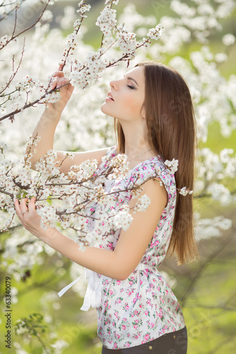 Beautiful young girl at green spring nature