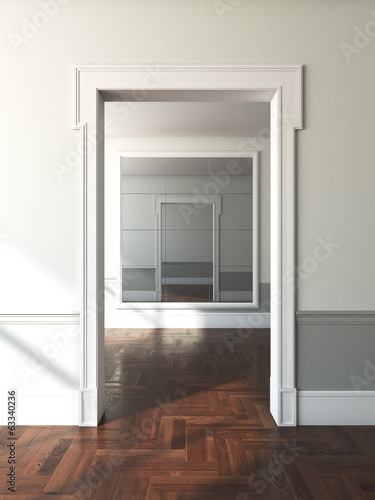 doorway to empty room with mirror