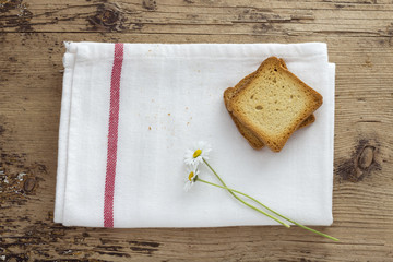 Toast and Daisy Flower on Wooden background