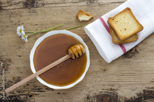 Toast and honey on Wooden background