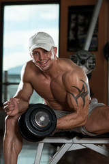 Young Man Working Out In A Health Club