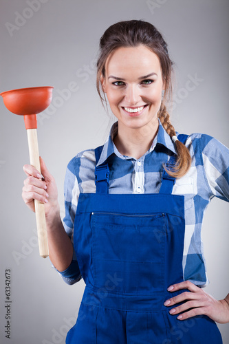 Woman with a plunger
