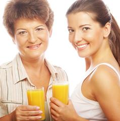 Two women with orange juice.