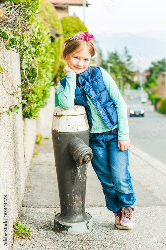 Outdoor portrait of a cute little girl on a nice sunny day