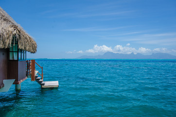 Overwater bungalow with steps into amazing blue lagoon