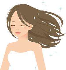 髪をなびかせ目を閉じる女性