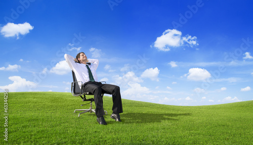 Businessman Relaxing on the Field