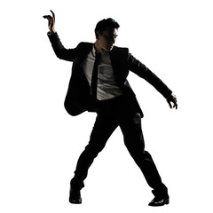 Silhouette of Asian businessman dancing or posing