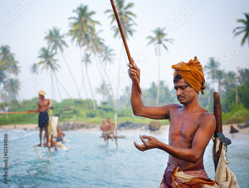 Stilt fishermen in Sri Lanka