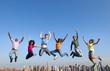 Obrazy na płótnie, fototapety, zdjęcia, fotoobrazy drukowane : Group of Multi Racial People Jumping in the City