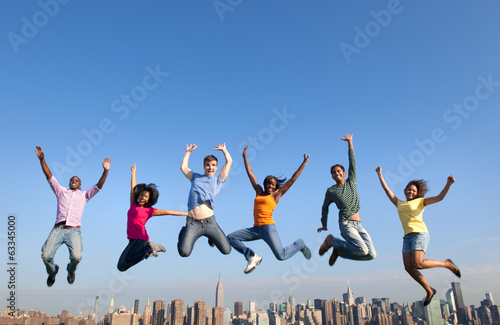 Group of Multi Racial People Jumping in the City