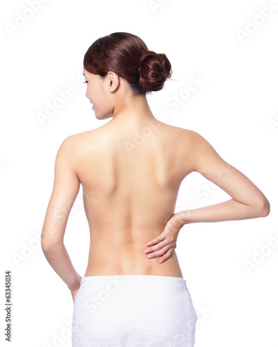 woman smile touch her back