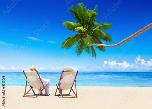 Couple Relaxing on the Tropical Beach