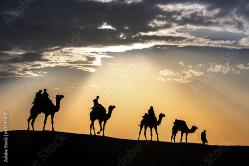 Foto op Canvas Kameel desert local walks with camel through Thar Desert